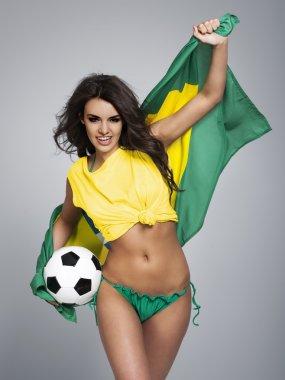 Woman cheering of brazilian team