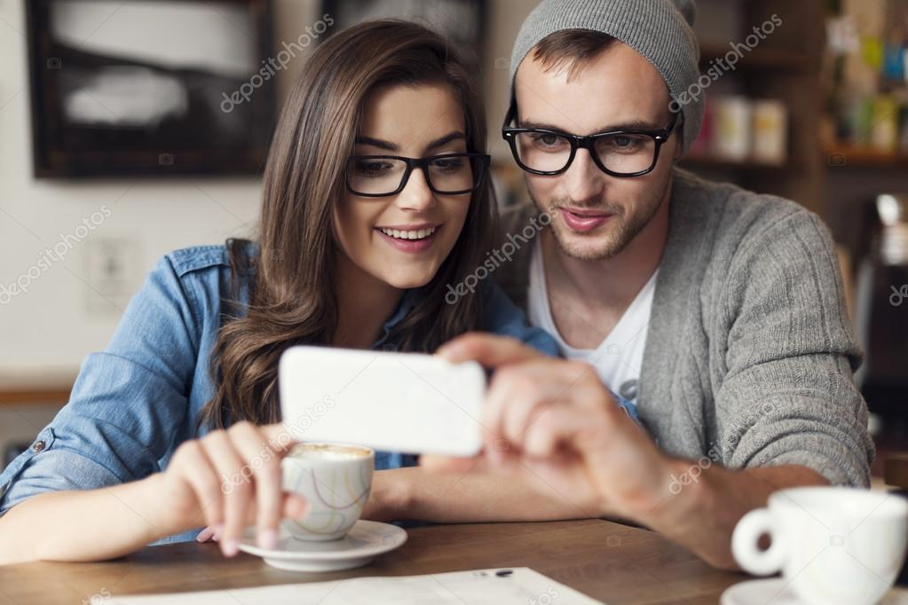 Hipster couple using mobile phone