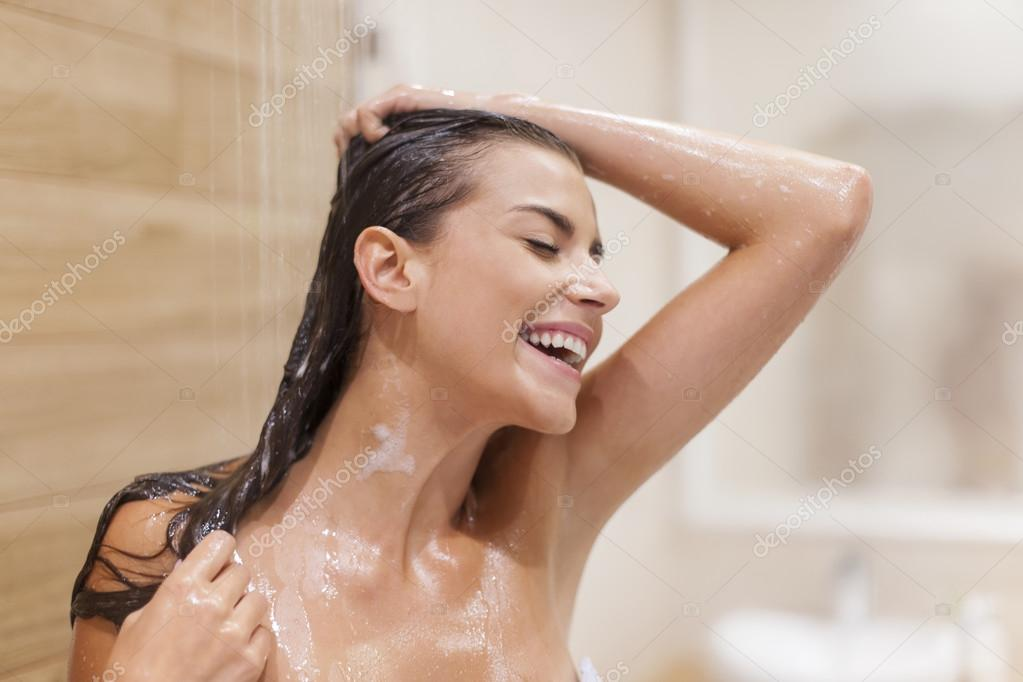 Woman has fun under the shower
