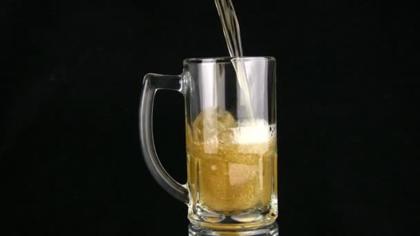 The beer is poured in a mug. Black background