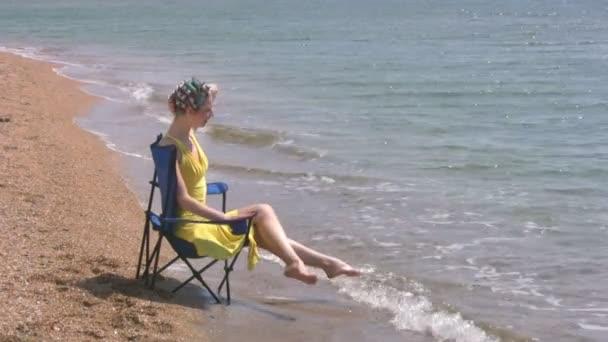 Beach, yellow dress, blue chair