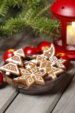 Bowl of gingerbread cookies on rustic grey wooden table