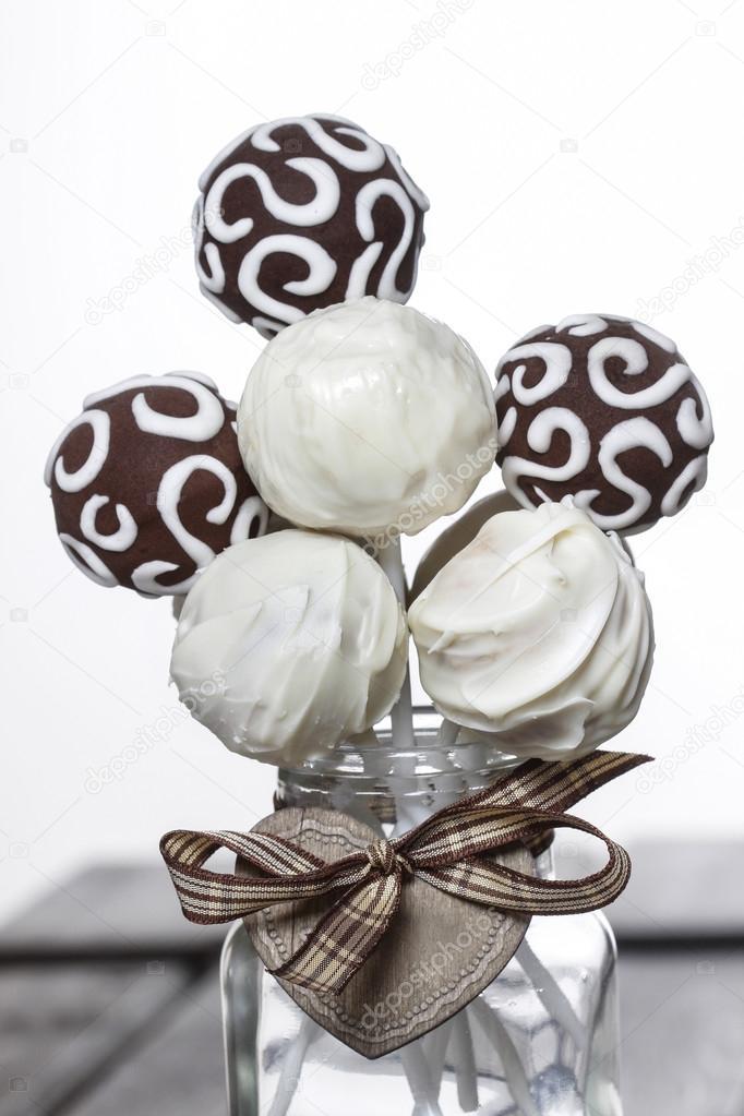 Chocolate cake pops on white background