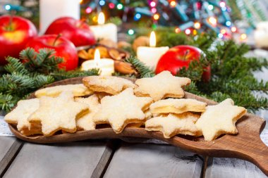 Homemade biscuits in star shape on wooden table in christmas eve