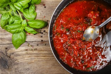 Red sauce made of dried tomatoes on frying pan