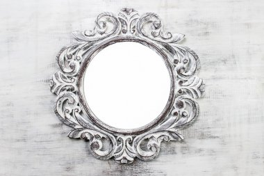 Rustic wooden round frame on grey background. Copy space