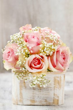 Bouquet of pink roses in wooden shabby chic box. Copy space