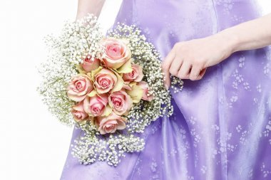 Beautiful young woman holding bouquet of pink roses
