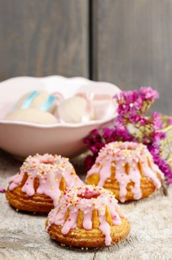 Traditional easter yeast cake decorated with pink icing