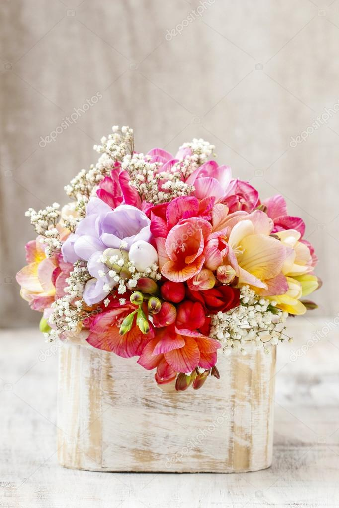 Bouquet of colorful freesia flowers in wooden shabby chic box ...