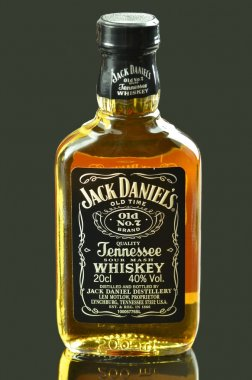 Small bottle of Jack Daniels whiskey isolated on dark background stock vector