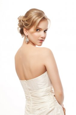 Beauty woman with wedding hairstyle and makeup. Bride fashion. J