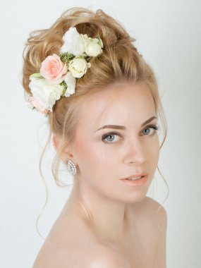 Beauty woman with wedding hairstyle and makeup. Bride fashion.