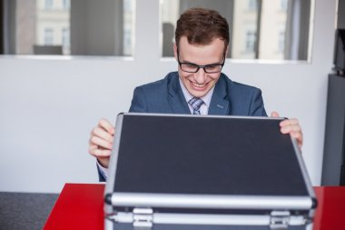 Smiling businessman with briefcase