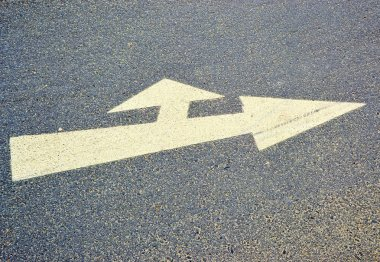 An arrow on the asphalt