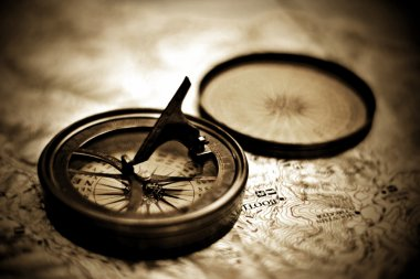 Vintage Sundial Compass On Top Of Map