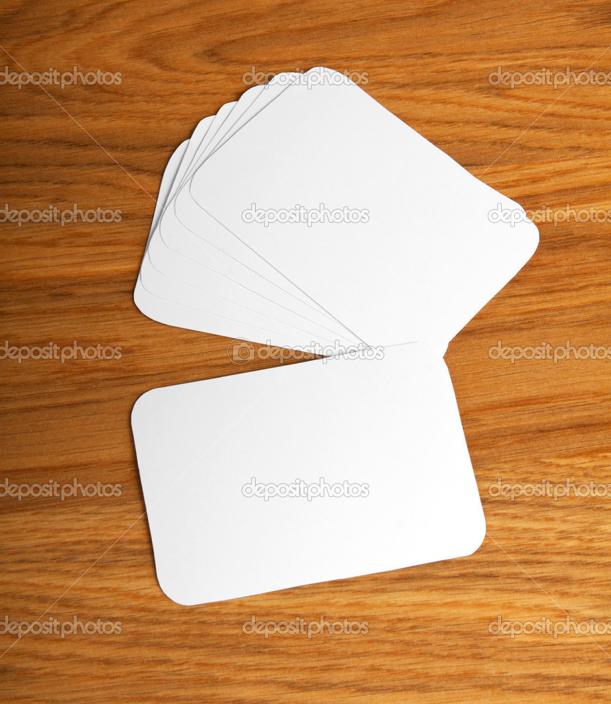 Blank business cards with rounded corners on a wooden background blank business cards with rounded corners on a wooden background stock photo reheart Choice Image