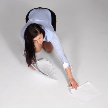 Young woman raised fallen documents