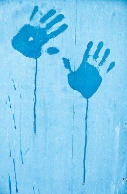 Fingerprints of blue paint