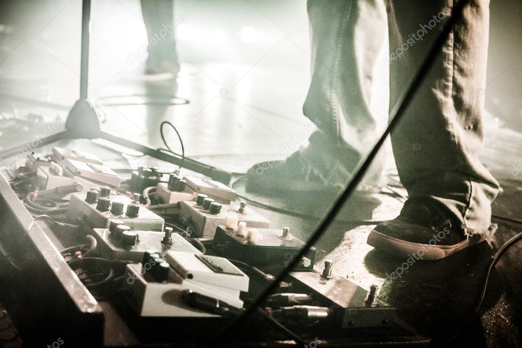 Guitar Pedals On A Stage With Live Band Performing During Show Stock Photo