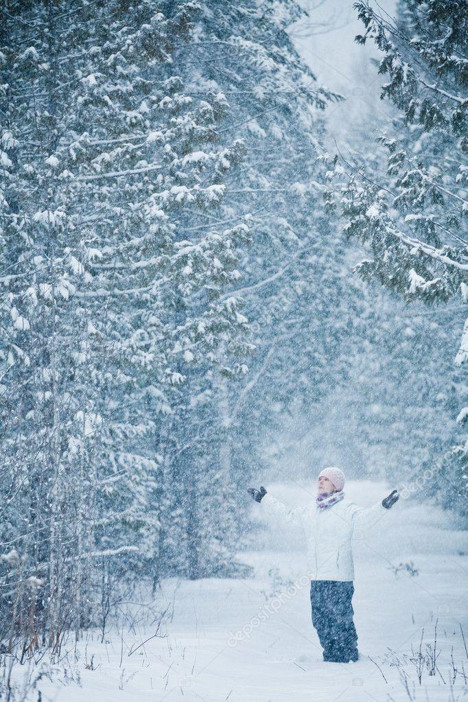 Happy Cute Woman in Forest Enjoying Winter