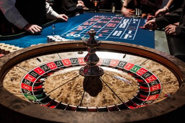 Wooden Shiny Roulette Details in a Casino and People