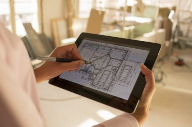 Architect woman working with electronic tablet