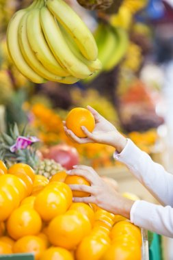 Woman buys fruits and vegetables at a market
