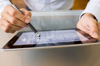 Architect working with stylus and digital tablet pc