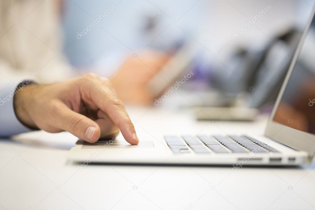 Businessman hands typing on laptop