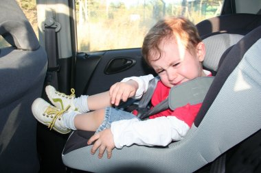Baby in car seat for safety, unhappy