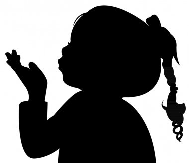 A child blowing out, head silhouette