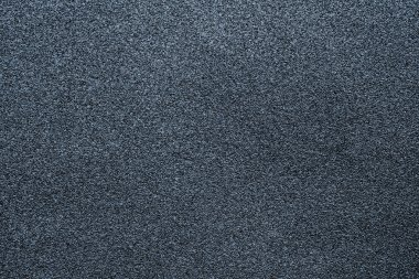 Fine-grained texture of a gray abrasive material