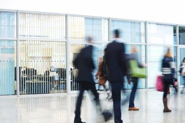 Businesspeople Rushing through Corridor, Motion Blur