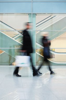 Commuters Walking Quickly down Hall in Office Building