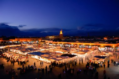 Evening busy market square Djemaa El Fna in Marrakesh, Morocco.