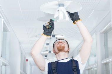 Man Fixing Lamp