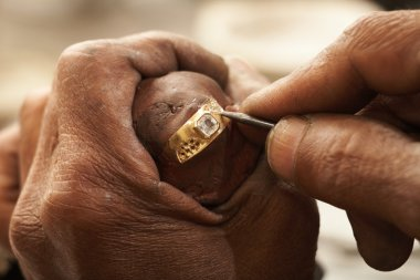 Goldsmith working on an unfinished 22 carat gold Wedding ring