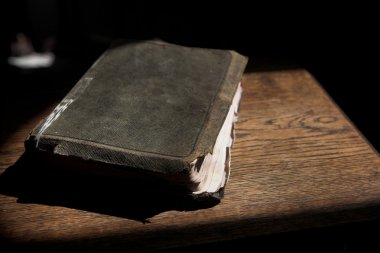 old bible lying on a wooden table