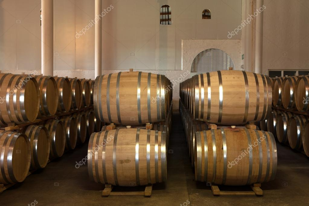 stacked oak barrels maturing red wine. Stacked Oak Barrels For Maturing Red Wine And Brandy In A Cooling Cellar \u2014 Stock Photo C