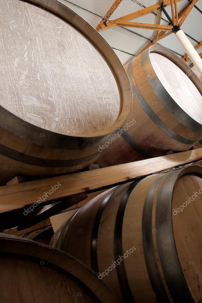 stacked oak barrels maturing red wine. Stacked Oak Barrels For Maturing Red Wine And Brandy In A Cooling Cellar \u2014 Stock Photo L