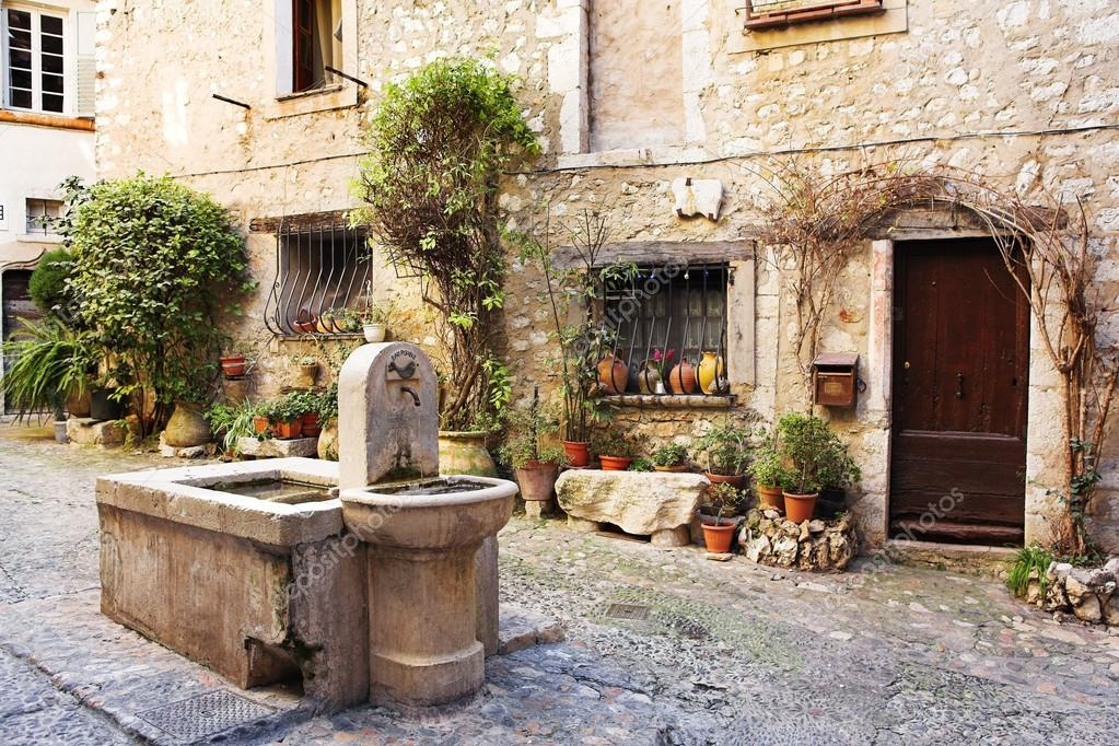 Fresh water fountain in the centre of the quaint little French hilltop village of Saint-Paul de Vence, Southern France, Alpes Maritimes, next to the Mediterranean sea - A Heritage Site