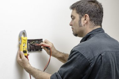 Technician working on a thermostat