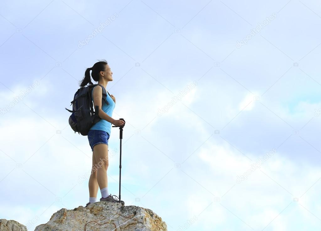 Woman enjoy view at mountain peak