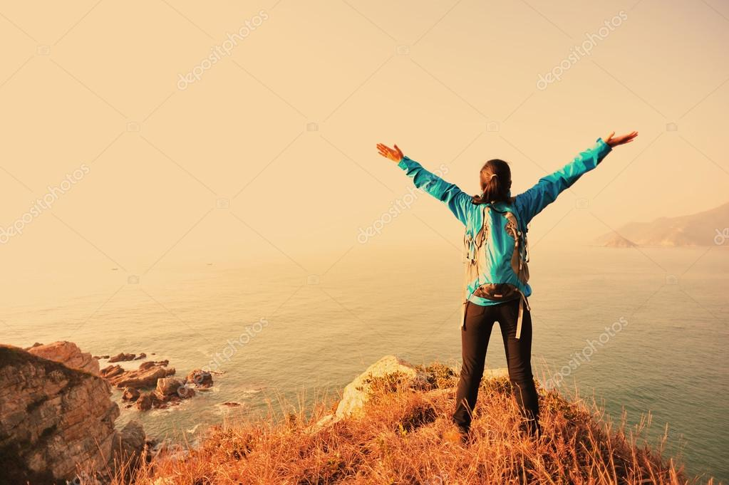 Woman open arms to the sunrise