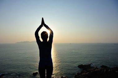 Woman practices yoga
