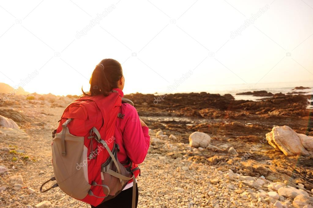 Hiking woman stand seaside