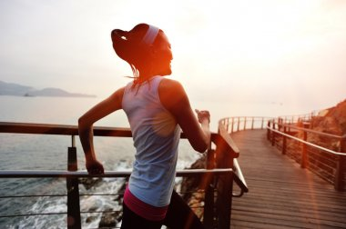 woman running on wooden pier