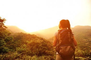 Woman enjoy the beautiful view at mountain peak
