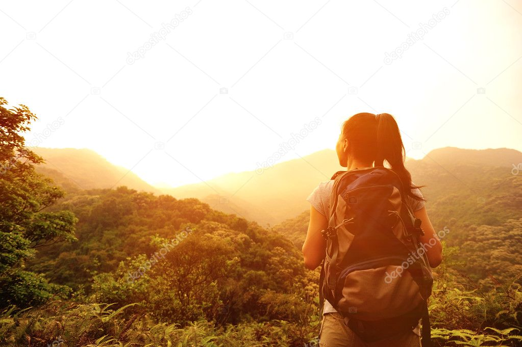 Woman enjoy the beautiful view at mountain peak